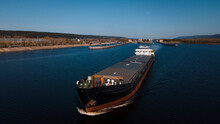 Top-view Of A Cargo Ship Passing By The Gateway