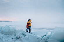Winter Love Story. Young Couple Having Fun On The Frozen Lake