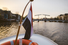 Dutch Flag On A Boat By Sunset - Amstel, Amsterdam (the Netherlands)
