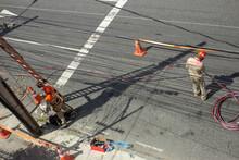 Men Repairing Electrical Grid ...