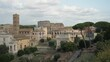 Ruins of the Roman Forum,Columns and stones of old monument and famous Colosseum,Rome, Italy.