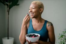 Black Woman Eating Healthy Fruit And Berries