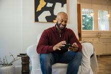 Black Man Watching Sports On S...