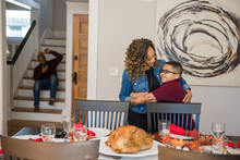 Black Son Helps Mother Do Holiday Table Setting