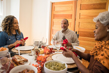 Black Multigenerational Family Eating Thanksgiving Holiday Meal