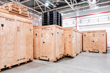 Wooden Boxes In The Warehouse. Boxes Out Of Wood For Packing Industrial Machinery. Warehousing. Packaging Of Finished Products Of The Plant. Sale Of Packaging Materials.