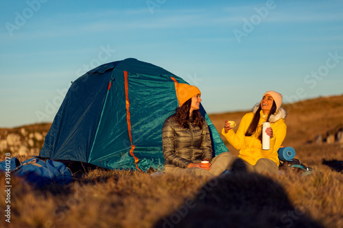 Girls camping on mountain with a tent Canvas