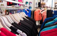 Sportswear On Hangers In Sports Goods Shop