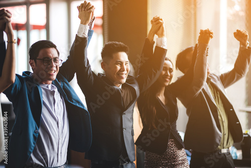 Group of business people crossed arms in pile for win Wallpaper Mural