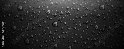 Photo Water drops on black glass background
