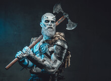Northern Risen From The Dead Chief In Dark Armour With Fur With Iced Skin And Blue Eyes Holding Axe On His Shoulder In Moonlight.