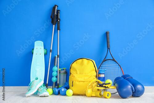 Obraz Set of sport equipment on floor near color wall - fototapety do salonu