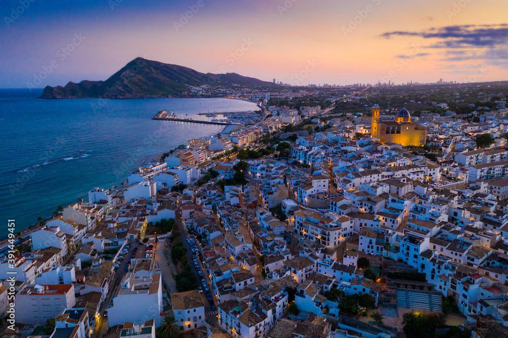 Fototapeta Scenic aerial view at twilight of Altea cityscape on Mediterranean coast overlooking illuminated Church of La Mare de Deu del Consol, Spain