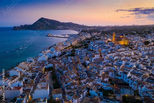 Obraz Scenic aerial view at twilight of Altea cityscape on Mediterranean coast overlooking illuminated Church of La Mare de Deu del Consol, Spain - fototapety do salonu