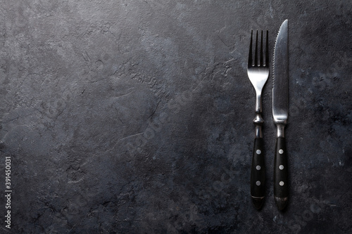 Fotografia Stone table with knife and fork