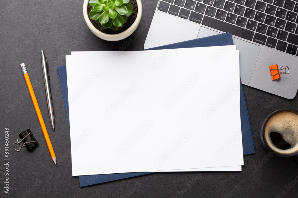 Fototapeta Office workplace table with blank paper page