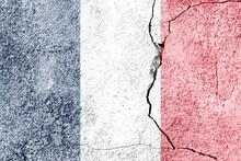 France Flag On Cracked Concret...
