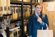 Young Blond Woman Taking Off Her Face Mask, Shopping I