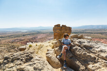Boy Hiking To The Top Of Chimney Rock Landmark In A Protected Canyon Landscape