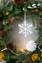 Christmas Decorations, Close Up Of White Pine Cone And Snowflake On Christmas Wreath.