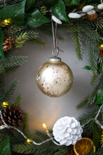 Christmas Decorations, Close Up Of Golden Bauble And And White Pine Cone On Christmas Wreath.