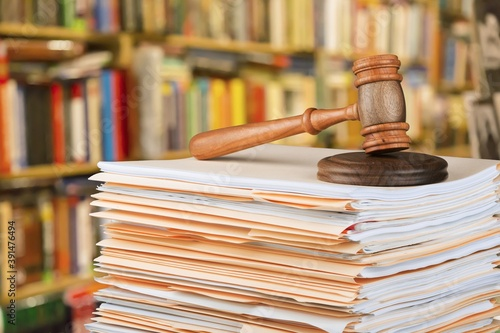 Fotografering Judge wooden hammer and stack documents