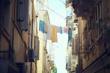 Linen Is Dried In A Narrow Str...