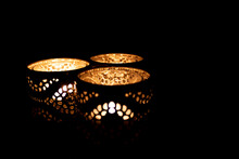 Three Burning Candles In Golde...