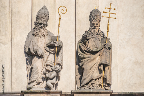 Fotografie, Tablou Ancient decorative top facade statues of priests, bishops at Saint Salvator chur