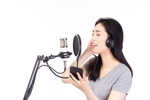 Singer Asian Woman With Microp...