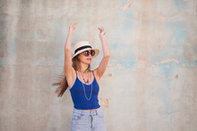 Portrait Of Beautiful Girl Dancing On A Colored Background