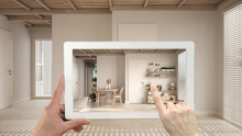 Augmented Reality Concept. Hand Holding Tablet With AR Application Used To Simulate Furniture And Design Products In Empty Interior With Ceramic Tiles. Living Room, Table, Bookshelf