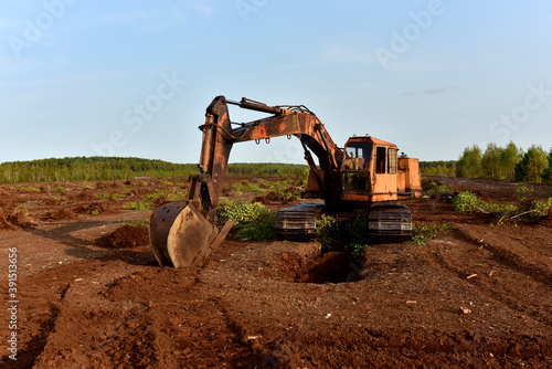 Stampa su Tela Excavator digging drainage ditch in peat extraction site