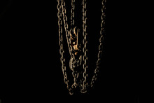 Darkness. A Metal Chain With A...