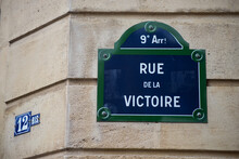 Closeup Of Victory Street Name...
