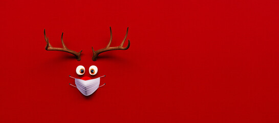Panel Szklany Boks Reindeer toy with cold red nose and medical mask on red Christmas Corona background 3D Rendering