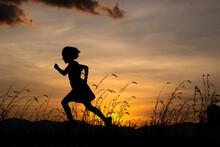 Silhouette Of Child Girl Runni...