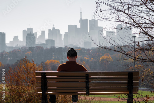 Fototapeta premium Young man looking to downtown Toronto