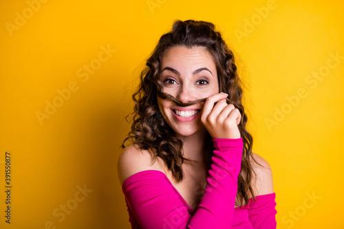 Fototapeta Photo portrait of goofy girl making hair moustache smiling holding with hand wea