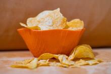 Closeup Shot Of Corn Chips In An Orange Bowl