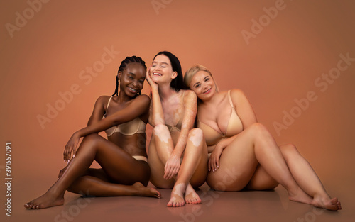 Fényképezés Group of women with different body types and ethnicity sitting in underwear