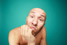 Portrait Of Funny Naked Bald Man Isolated On Green Background