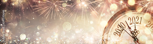 Fototapeta Happy New Year 2021 - Abstract Defocused Background - Clock And Fireworks Waitin