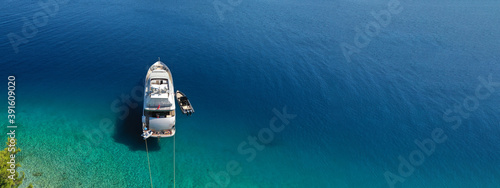Canvas Print Aerial drone ultra wide panoramic photo of luxury yacht anchored in tropical exo