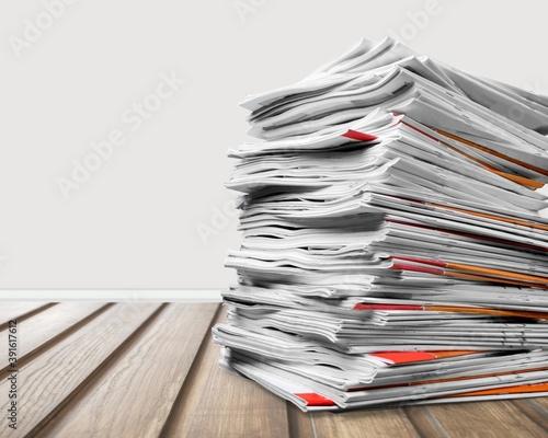 Fototapeta Stack file folders with documents on the desk obraz