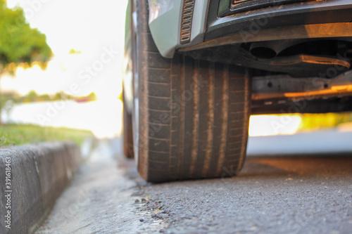 Canvastavla Car parked near the sidewalk