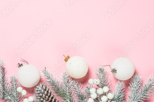 Fotografiet Christmas pink flat lay background with holiday decorations.