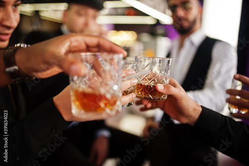 Cheers! Group of handsome retro well-dressed man gangsters spend time at club Wallpaper Mural