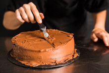 Men's Hands Decorating Chocola...