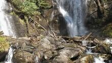 Waterfall Sprays On Rocks Beneath Anna Ruby Falls, 4k, 60fps